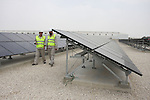 Palestinian employees work at the solar power station in the West Bank city of Jericho on September 30, 2012. Photo by Issam Rimawi