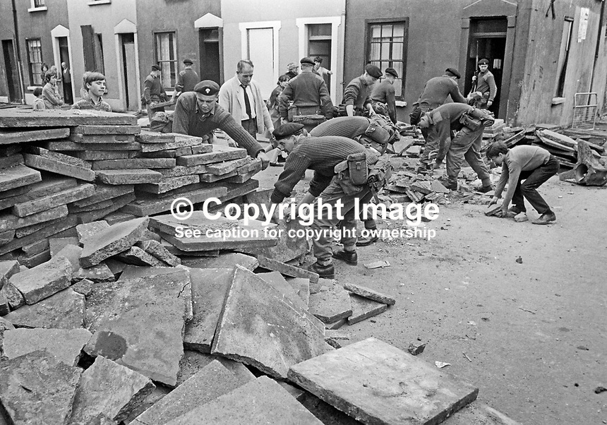 Troops, with some assistance from local residents, removing one of a number of barricades in the Lower Falls Road area of Belfast, N Ireland. 196009160250b, 250/69.<br /> <br /> Copyright Image from Victor Patterson,<br /> 54 Dorchester Park, Belfast, UK, BT9 6RJ<br /> <br /> t1: +44 28 90661296<br /> t2: +44 28 90022446<br /> m: +44 7802 353836<br /> <br /> e1: victorpatterson@me.com<br /> e2: victorpatterson@gmail.com<br /> <br /> For my Terms and Conditions of Use go to<br /> www.victorpatterson.com