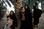 Marsh Arabs. Southern Iraq. Circa 1985. Marsh Arab women and children collecting water banks of river Tigris.