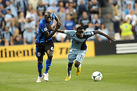 KANSAS CITY, KS - June 1, 2013:<br /> Peterson Joseph (19) midfield Sporting KC holds off Hassoun Camara (6) midfield Montreal Impact .<br /> Montreal Impact defeated Sporting Kansas City 2-1 at Sporting Park.
