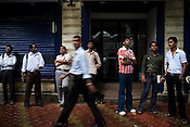 Traders stare at the changing stock numbers outside the Bombay Stock Exchange in Mumbai, India.