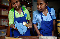 February 23rd, 2013_ Baucau, TIMOR-LESTE_ Members of the Ai-Funan soap, woman's cooperative in Baucau, Timor-Leste use bamboo to make a round version of their all natural handmade soap bars.    Photographer: Daniel J. Groshong/The Hummingfish Foundation