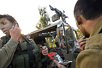 Israeli infantry soldiers camouflage their faces, before they are deployed near the Israel-Gaza border. Israeli forces began an air offensive against Hamas in Gaza on 27/12/2008, which quickly escalated into an offensive by land, sea and air, in retaliation against Palestinian rockets fired into Israel. After eight days of bombardment, leaving over 400 Palestinians and four Israelis dead, Israeli tanks entered Gaza on 04/01/2009...