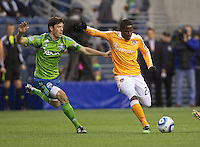 Houston Dynamo defender Hunter Freeman passes the ball in front of Seattle Sounders FC midfielder Brad Evans during play between the at Qwest Field in Seattle Friday March 25, 2011. The match ended in a 1-1 draw.