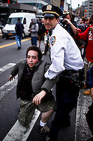 A Occupy Wall Street member is detained by NYPD officers during a  march against police brutality in New York, United States. 24/03/2012.  Photo by Eduardo Munoz Alvarez / VIEWpress.