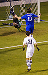 UK's defensive player Marco Bordon watches as keeper Jack Van Arsdale reacts a fraction of a second too late to a shot from Xavier's Luke Spencer.