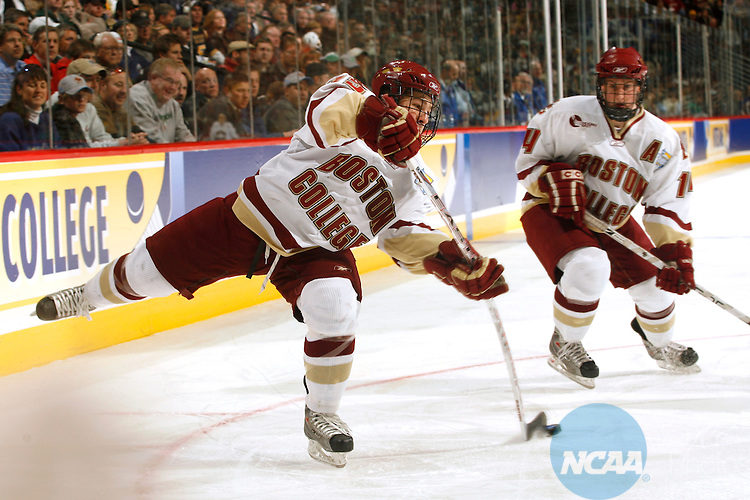 12 APR 2008:  Joe Whitney (15) of Boston College fires a shot on goal during the Division I Men's Ice Hockey Championship held at the Pepsi Center in Denver, CO.  Jamie Schwaberow/NCAA Photos