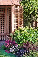 Garden gazebo building with hydrangeas