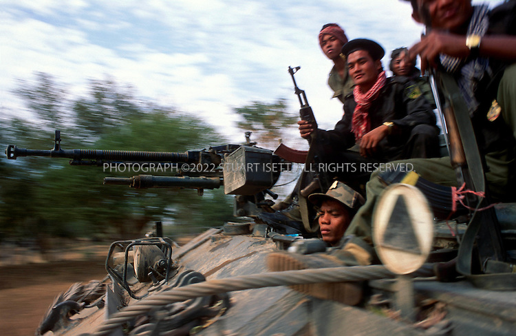 January, 1996--Battambang, Cambodia.<br /> <br /> A Cambodian government tank heads towards Kilo 38 to fight Khmer Rouge troops.<br /> <br /> All photographs &copy;2003 Stuart Isett.All rights reserved.This image may not be reproduced without expressed written permission from Stuart Isett.