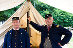 Old Bethpage, New York, USA - July 21, 2012: BOB HANSEN (R) of Sea Cliff, NY, portrays Company Clerk, and GUY SMITH (R) of Huntington, NY, portrays Regimental Adjutant, at re-creation of Camp Scott, a Union Army training camp, at Old Bethpage Village Restoration, to commemorate 150th Anniversary of American Civil War.