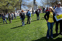 Boston, Massachussets, April 14, 2010 - Tea Party supporters and protestors gathered in the Boston Common for a Tea Party Express rally, the second to last stop on their 43-city tour across the country. The tour which began in Searchlight, NV, hometown of Senate Majority Leader Harry Reid, will conclude tomorrow in Washington, D.C.  for a tax day rally. Anti-incumbent sentiment is a common theme at the rallies.
