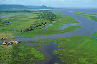 Aerial view of lower Amazon floodplain at low water level during dry season showing uncovered grasslands and a group of farms