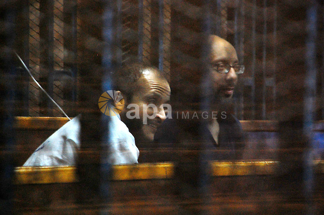 Members of Muslim Brotherhood sit inside a defendant's cage during the trial of former Egyptian President Mohamed Morsi in Cairo, Egypt on May 24, 2015. Cairo Criminal Court resumed Sunday the espionage trial of ousted president Mohamed Morsi and 10 co-defendants over charges of leaking to a foreign country, namely Qatar, top secret military reports pertaining to Egypt's Intelligence Authority and Armed Forces and related to the country's national security. Photo by Stringer