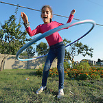 Majlinda Kuci, a 10-year old refugee from Kosovo, plays with a hula hoop in a government-run refugee center in Vamosszabadi, Hungary. Hungarian Interchurch Aid, a member of the ACT Alliance, provides child care and other services to residents in the center, who come from Syria, Iraq and other countries and are bound for western Europe.