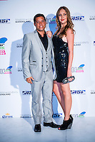 SURFERS PARADISE, Queensland/Australia (Friday, March 1, 2013) Adriano de Souza (BRA)  and partner. - The world's best surfers congregated last night at the QT Hotel in Surfers Paradise to celebrate the 2013 ASP World Surfing Awards, officially crowning last year's ASP World Champions and welcoming in the new year..Joel Parkinson (AUS), 31, long considered to be a threat to the ASP World Title ever since his inception amongst the world's elite over a decade ago, was awarded his maiden crown last night. Amidst a capacity crowd of the world's best surfers and hometown supporters, the Gold Coast stalwart brought the house down with a heartfelt and emotional speech..?It's beautiful to have everyone here tonight,? Parkinson said. ?We all come together and really celebrate last season amongst our friends and family. The new year, for me, begins tomorrow. Tonight, I just feel so fortunate to be up here and to be supported by my beautiful family. I love them and am only here because of them.?.FULL LIST OF AWARDS' RECIPIENTS:.2012 ASP World Champion: Joel Parkinson (AUS).2012 ASP World Runner-Up: Kelly Slater (USA).2012 ASP Rookie of the Year: John John Florence (HAW).2012 ASP Women's World Champion: Stephanie Gilmore (AUS).2012 ASP Women's World Runner-up: Sally Fitzgibbons (AUS).2012 ASP Women's Rookie of the Year: Malia Manuel (HAW).2012 ASP Breakthrough Performer: Sebastian Zietz (HAW).2012 ASP Women's Breakthrough Performer: Lakey Peterson (USA).2012 ASP World Longboard Champion: Taylor Jensen (USA).2012 ASP Women's World Longboard Champion: Kelia Moniz (HAW).2012 ASP World Junior Champion: Jack Freestone (AUS).2012 ASP Women's World Junior Champion: Nikki Van Dijk (AUS).ASP Life Member/Chairman Emeritus: Richard Grellman.ASP Service to the Sport: Randy Rarick.Peter Whittaker Award: Adrian Buchan.2012 ASP Men's Heat of the Year (Fan Vote): Mick Fanning (AUS) vs. Kelly Slater (USA) - Rip Curl Pro Bells Beach.2012 ASP Women's Heat of the Year (Fan Vote): Laura Enever (AUS