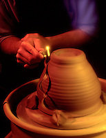 Hands form forming preparing molding clay for pot art artwork potter craftsman works clay..pottery forming..