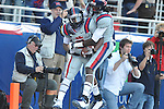 Ole Miss running back Jeff Scott (3) runs 83 yards for a touchdown against Auburn and is conratulated by Ole Miss wide receiver Melvin Harris (5) in a college football game on Saturday, October 30, 2010. Auburn won 51-31.
