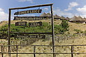 27/01/12. Simien Lodge, Gondar, Ethiopia. Simien Lodge is the highest lodge in Africa, residing at 3,260 metres above sea level. View of the guest bungalows through the lodge sign. Photo credit : Jane Hobson.
