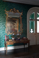 A gilt-framed mirror in the entrance hall reflects King Charles I of England out Hunting, c. 1635 by Sir Anthony Van Dyke