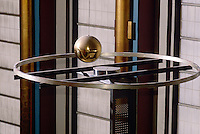 FOUCAULT PENDULUM<br /> Shows Axial Rotation of the Earth<br /> United Nations building.<br /> A simple pendulum suspended from a long wire and set into motion along a meridian. Plane of motion turns clockwise in N.Hemisphere and counterclockwise in S.Hemisphere, demonstrating axial rotation of earth. [After Jean Bernard L Foucault&eacute;on]