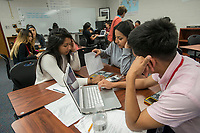 NWA Democrat-Gazette/ANTHONY REYES @NWATONYR<br /> Jackie Escobar (from left) Amy Chacon and Michael Martinez work on a math problem Thursday, April 13, 2017 in their Algebra II class at Springdale High School. The class uses more group based learning to understand the material.