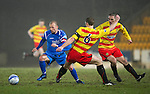 St Johnstone v Partick Thistle....09.02.11  Scottish Cup 5th Round.Jody Morris evades a tackle by Alan Archibald.Picture by Graeme Hart..Copyright Perthshire Picture Agency.Tel: 01738 623350  Mobile: 07990 594431