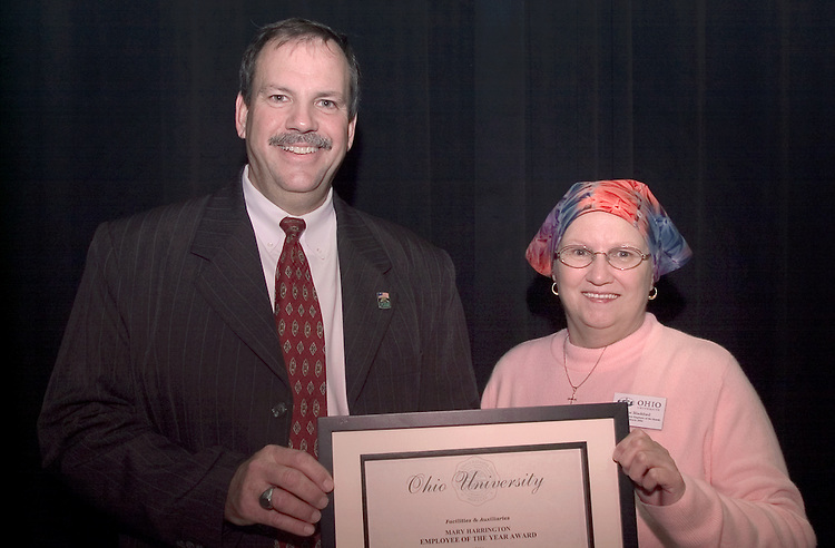 16804Mary Harrington presenting the Employee of the Year award to Jane Blackford, Dining Services 12/2004..Sherwood Wilson & Jane together