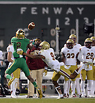 (Boston, MA, 11/21/15) Notre Dame's Chris Brown hauls in a pass over Boston College's John Johnson during the third quarter as Notre Dame hosts Boston College at Fenway Park in Boston on Saturday, November 21, 2015. Photo by Christopher Evans