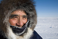 Gjoa Haven is a town in the far north of the Northwest Territories in Canada where over 1000 Inuits live. Here an Inuit hunter surveys the landscape for prey.