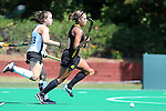 30 August 2014: Iowa's Natalie Cafone (right) is chased by Wake Forest's Shannon Eby (CAN) (19). The Wake Forest University Demon Deacons played the University of Iowa Hawkeyes at Francis E. Henry Stadium in Chapel Hill, North Carolina as part of the ACC/Big 10 Challenge and an 2014 NCAA Division I Field Hockey match. Iowa won the game 4-1.