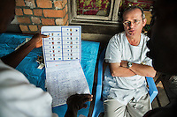 Ophthalmologist Doctor Richard Hardi discusses the case load with his team in the remote village of Pania. <br /> <br /> From his base in Mbuji Mayi Hungarian ophthalmologist Friar Richard Hardi and his team travelled deep into the Congolese rainforest, by 4x4 and canoe, to treat people in isolated communities most of whom have never seen an ophthalmologist. At a small village called Pania they established a temporary field hospital and over the next three days made hundreds of consultations. Although both conditions are preventable, many of the patients they saw had Glaucoma or River Blindness (onchocerciasis) that had permanently damaged their eyesight. However, patients with cataracts, a clouding of the eye's lens, who were suitable for treatment were booked for an operation. For two days the team carried out the ten minute procedure on one patient after another. The surgery involves making a 2.2mm incision into the remove the damaged lens that is then replaced by an artificial one. Doctor Hardi is one of the few people willing to make such a journey but is inspired to do so by his faith and, as he says: 'Here I feel that I can really make a difference in people's lives'. /Felix Features