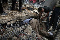 Beirut, Lebanon, Aug 13 2006.Rescuers frantically search the rubble in the probably vain hope to find survivors. A massive Israeli Air Force bombing destroyed 11 building blocks in the southern Beirut neighbouhood of Rwaiss, including the Imam Hassan school, totally levelled by more than 20 powerful bombs; more than 20 people, including children playing in the area are said to have lost their lives as a result of this 11th hour Israeli operation..