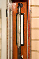 WALL MOUNTED MERCURY BAROMETER<br /> Measures Atmospheric Pressure<br /> Readings are taken by first adjusting the mercury level in the cistern to a zero point and then moving a vernier to the top of the mercury column.