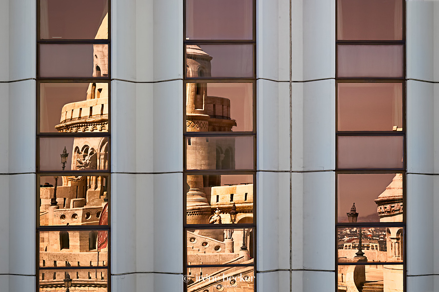 Reflection of Fishermen's Bastion in window of Hilton Hotel. Budapest, Hungary.
