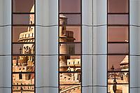 Reflection of Fishermen's Bastion in window of Hilton Hotel. Budapest, Hungary.