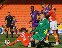 Cheltenham Town's Scott Brown gets to the ball ahead of Blackpool's Kelvin Mellor<br /> <br /> Photographer Alex Dodd/CameraSport<br /> <br /> The EFL Sky Bet League Two - Blackpool v Cheltenham Town - Saturday 22nd April 2017 - Bloomfield Road - Blackpool<br /> <br /> World Copyright &copy; 2017 CameraSport. All rights reserved. 43 Linden Ave. Countesthorpe. Leicester. England. LE8 5PG - Tel: +44 (0) 116 277 4147 - admin@camerasport.com - www.camerasport.com