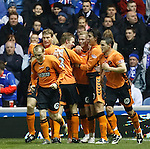 Scott Robertson scores Dundee Utd's third goal and is mobbed after a mistake by Allan McGregor