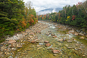 East Branch of the Pemigewasset River near the Lincoln Woods Trailhead during the autumn months in Lincoln, New Hampshire USA.