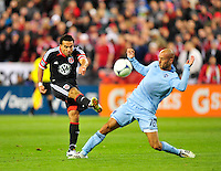 United's Dwayne Del Rosario shoots on goal and misses wide with Sporting KC's Aurelien Collin defending. Sporting Kansas City defeated D.C. United 1-0 during the MLS home opener at the RFK Stadium in Washington, D.C. on Saturday, March 10, 2012. Alan P. Santos/DC Sports Box