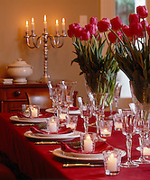 Fuchsia pink tulips lend a fresh and warm air to this winter inspired laid table