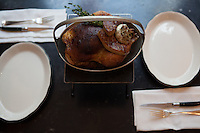 """Poule de Luxe"" For Two, whole roasted chicken, wild mushroom stuffed breast, seared foie gras and jus at Rotisserie Georgette in New York, NY on July 08, 2014. The restaurant has an open kitchen framed in beautiful blue-an-white Portuguese tile."