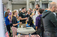 Workers from Closer speak to attendees at the TechDay New York event on Tuesday, April 18, 2017. Thousands attended to seek jobs with the startups and to network with their peers. TechDay bills itself as the U.S.'s largest startup event with over 500 exhibitors. (© Richard B. Levine)