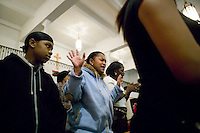 New York, USA - Congregation members pray during mass at the Greater Hood Memorial AME Zion Church, home of the Hip-Hop Church, in Harlem, New York, USA, 3 March 2005. Photo Credit: David Brabyn.