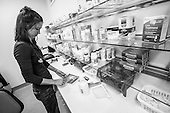 PA Jen Vaupel checks the medications in the dispensary at Bread for the City in Washington, DC. Caring for some of the most vulnerable patients in this medically under- served community is Vaupel's mission, one she shares with Bread for the City.