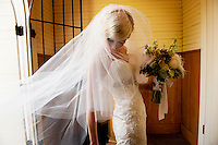 A bride gets ready to walk down the aisle in Emmanuel Church in Coloma, California. The bride and groom's reception was at the Coloma Country Inn.