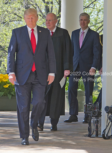 United States President Donald J. Trump leads Associate Justice of the United States Supreme Court Anthony Kennedy and new Associate Justice Neil Gorsuch from the Oval Office to the Rose Garden of the White House in Washington, DC for Gorsuch's Oath of Office ceremony in Washington, DC on Monday, April 10, 2017.<br /> Credit: Ron Sachs / CNP<br /> (RESTRICTION: NO New York or New Jersey Newspapers or newspapers within a 75 mile radius of New York City)