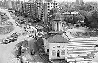 ROMANIA, Mosilor Av., Bucharest, 09.1982..Olari Church is moved and hidden behind a block of flats..© Andrei Pandele / EST&OST