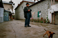 Gypsy in the rich gypsy village of Buzescu, Romania.April 2000.©Karen Robinson
