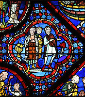 The 3 sons of Noah, from the Life of Noah stained glass window, 13th century, in the nave of Chartres cathedral, Eure-et-Loir, France. Chartres cathedral was built 1194-1250 and is a fine example of Gothic architecture. Most of its windows date from 1205-40 although a few earlier 12th century examples are also intact. It was declared a UNESCO World Heritage Site in 1979. Picture by Manuel Cohen