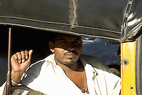 A typical Mumbai Tuk tuk driver motorized bike with cabin, in the streets of cental Mumbai,India